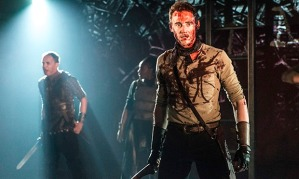 Tom Hiddleston, foreground, as Coriolanus, at the Donmar, London, December 2013.